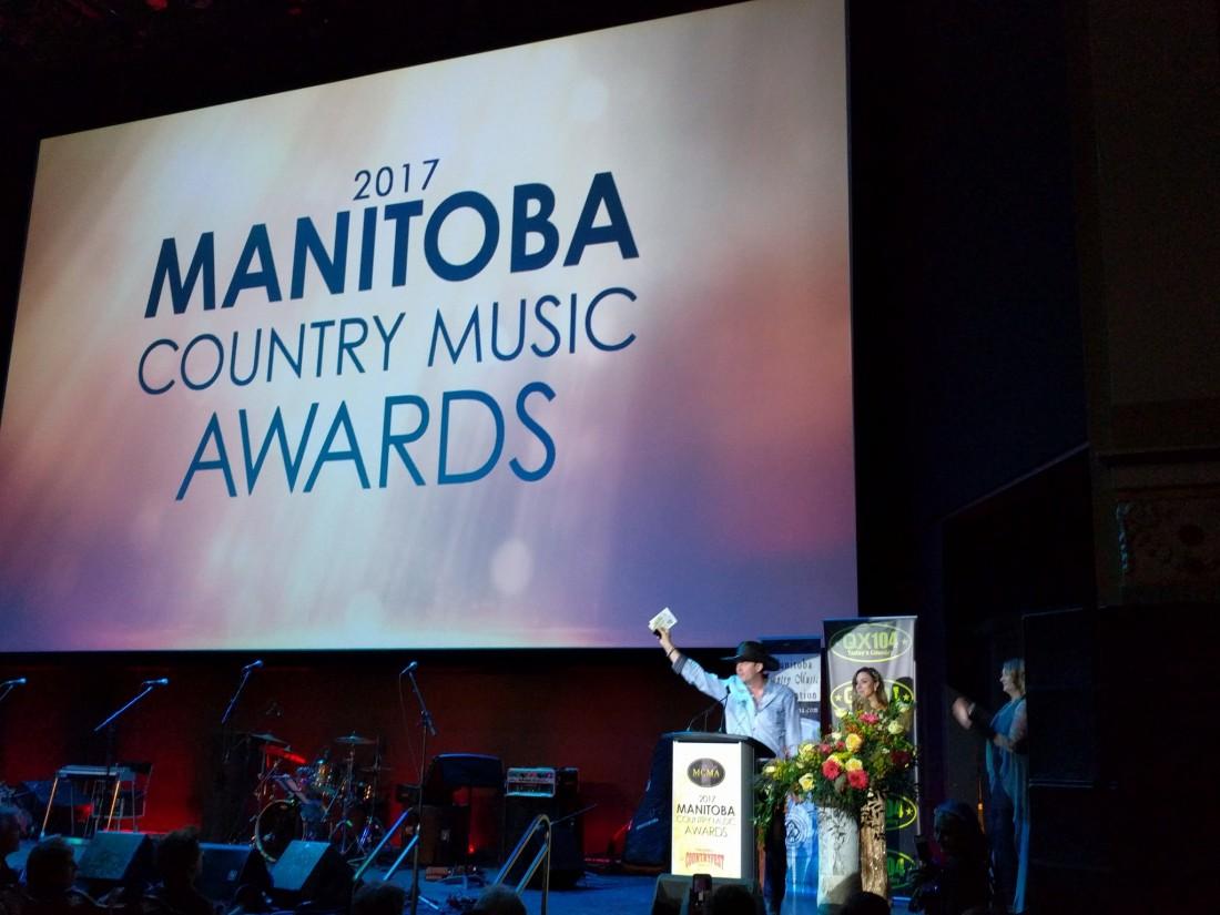 Ryan Keown accepts the Fan's Choice Award at the Manitoba Country Music Awards