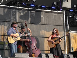 JD Edwards, Gilles Fournier, and Cara Luft on Main Stage at Winnipeg Folk Festival, July 10 (Photo: Sean McManus)